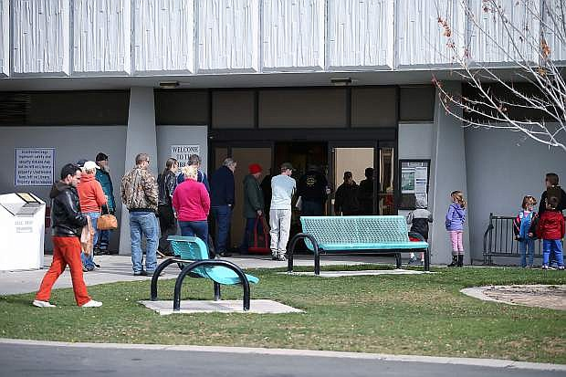 Patrons line up for the doors to open at the Carson City Library, in Carson City, Nev., on Tuesday, April 14, 2015. In an effort to better serve its patrons, the library will open on Sundays starting in June.