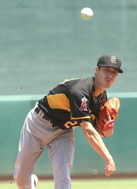 Former San Francisco Giants pitcher, now pitching for the Salt Lake Bees, Tim Lincecum delivers a pitch in a game against the Reno Aces on Tuesday, June 8, 2016, in Reno, Nev.