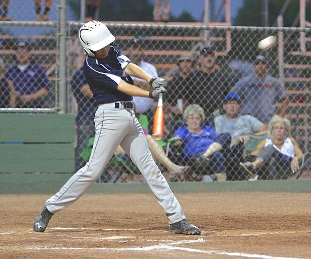 Carson 11-12 All-Star Brian Guthrie smacks a home run over the right field fence against Reno Centennial Thursday night at Governor's Field.