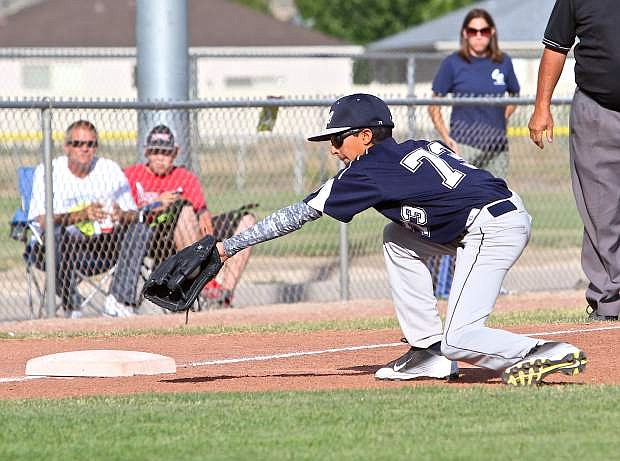 Third baseman Zaid Abdelhady backhands a grounder against South Tahoe Friday at Governor's Field.
