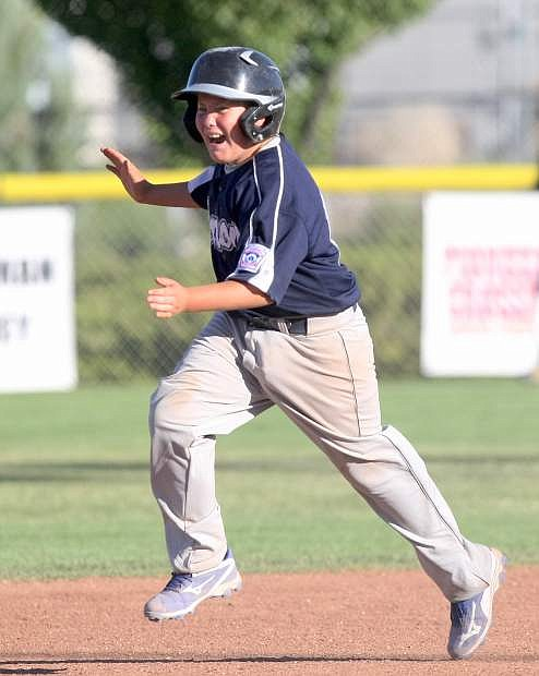 Tyler Palmer celebrates his 2-run home run as he rounds the bases in a game against the Reno Continentals on Tuesday.