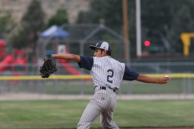 Ethan Good delivers a pitch to a Carson Valley batter on Monday night.