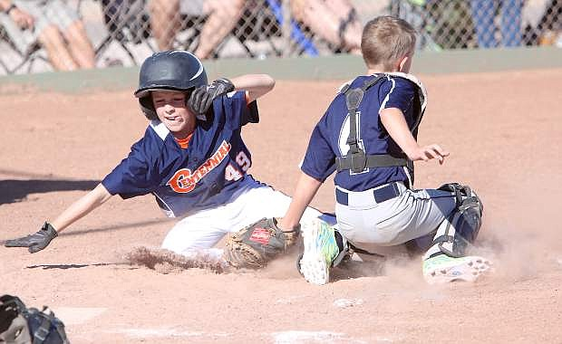 Nolan Pedersen puts the tag on a Sparks Centennial player at the plate in 9-10 all star play Thursday evening.