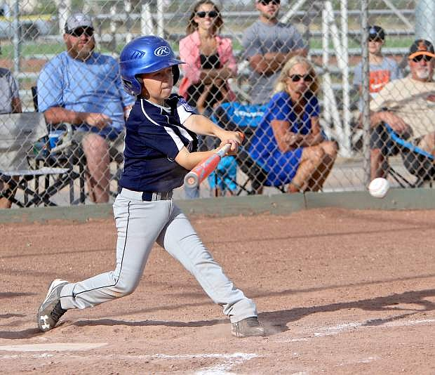 Colin Boekman gets a hit for the Carson 9-10 all stars Friday night.