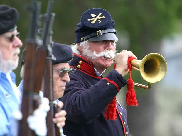 """Ray Ahrenholz plays """"Taps"""" at the Memorial Day ceremony at Lone Mountain Cemetery on Monday."""