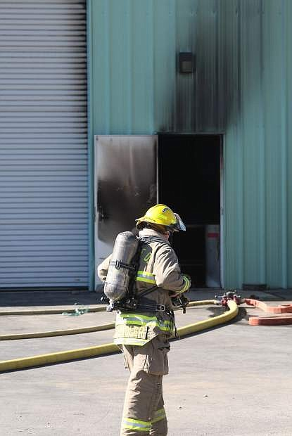 Firefighters respond to a structure fire on Industrial Parkway in Mound House on Tuesday morning.