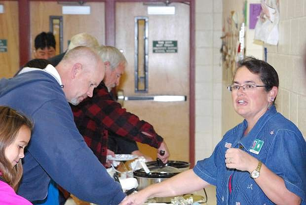 Librarian Jennifer Sanches serves breakfast to vetrans on Monday morning at Lahontan Elementary School.