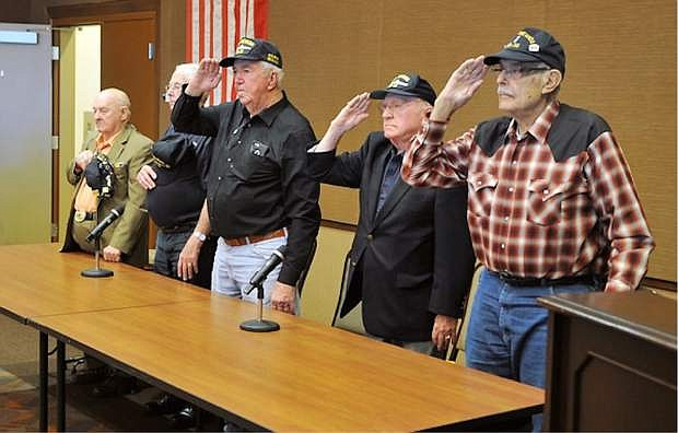 Veterans of the USS Nevada battleship salute a color guard Thursday during their first reunion in several years at the Nevada State Museum in Las Vegas.