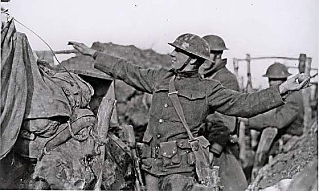 A soldier throws a grenade from one of the trenches.