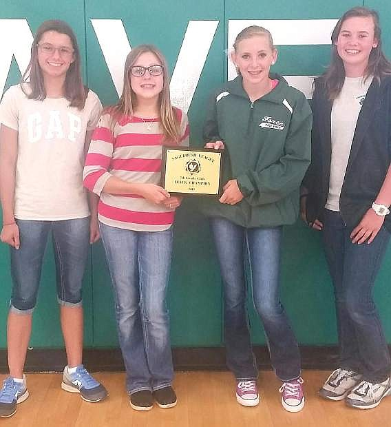 The 4x100-meter relay team from left are Madison Guerrero, Makenna Hanks, Karlee Hitchcock and Tiffany Sorensen set the Churchill County Middle School and Sagebrush Championships record in the event in May.