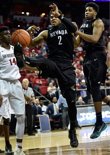 Nevada's Tyron Criswell (2) attempt to rebound the ball against San Diego State during the second half of an NCAA college basketball game in the semifinals at the Mountain West Conference tournament Friday, March 11, 2016, in Las Vegas. San Diego State won 67-55. (AP Photo/David Becker)