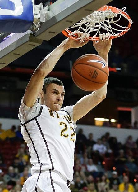 Wyoming's Larry Nance Jr. dunks during the second half of a Mountain West Conference men's tournament NCAA college basketball game, Tuesday, March 12, 2013, in Las Vegas. Wyoming won 85-81. (AP Photo/Julie Jacobson)
