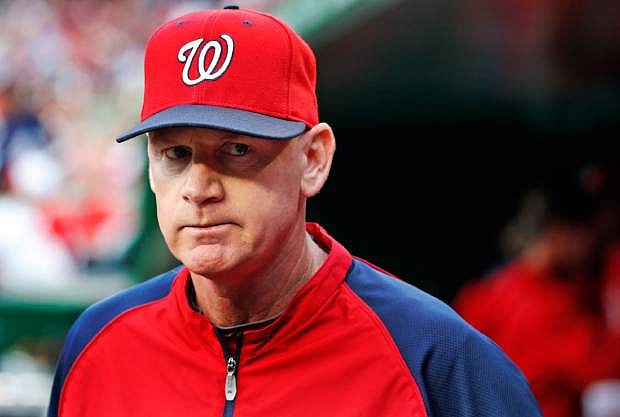 In this June 21, 2014, file photo, Washington Nationals manager Matt Williams walks in the dugout before the Nationals' baseball game against the Atlanta Braves in Washington. Williams has been chosen NL Manager of the Year after guiding the Nationals to the league's best record in his first season on the job. Williams got 18 first-place votes and 109 points in balloting by the Baseball Writers' Association of America announced Tuesday, Nov. 11. (AP Photo/Alex Brandon, File)