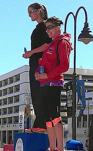 Fallon's Sarah Wilcox, left, and Kari Lister stand on the podium after finishing first and third, respectively, in the women's 30-34 age group of the half marathond at the Reno Downtown River Run on Sunday.