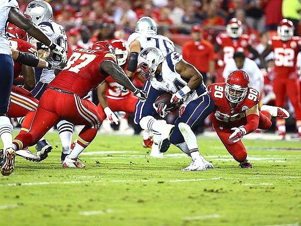 Kansas City linebacker Josh Mauga, right, and teammate Allen Bailey work to bring down New England running back Shane Vereen during the Chiefs' 41-14 rout over the Patriots on Monday in Kansas City.