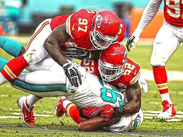 Former Nevada and current Kansas City linebacker James-Michael Johnson (52) wraps up New England running back Stevan Ridley during the Chiefs' 41-14 win on Monday.