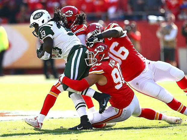 Kansas City linebacker Josh Mauga, bottom right, gets in on a tackle during the Chiefs' win over the New York Jets last week.