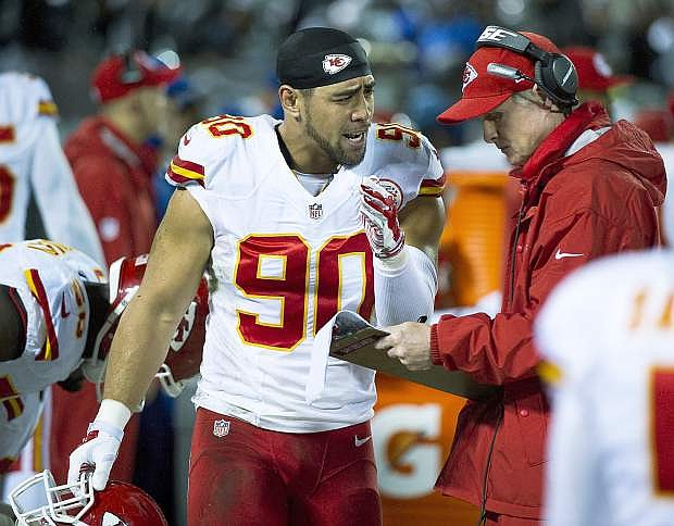 Chiefs defensive coordinator Bob Sutton, right, speaks with linebacker Josh Mauga during Kansas City's 24-20 loss to Oakland last week.