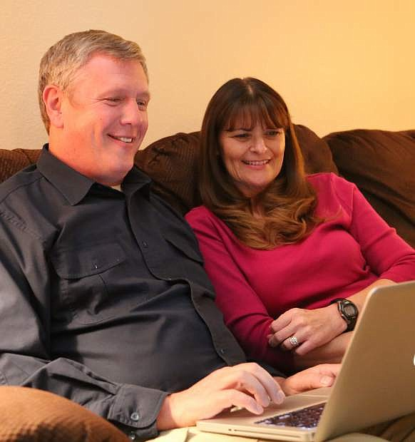 Carson City Mayor candidate Chris Carver looks at election results with his wife Lori on Tuesday night.