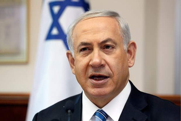 Israeli Prime Minister Benjamin Netanyahu chairs the weekly cabinet meeting in his office in Jerusalem, Sunday, April 6, 2014. Speaking at a weekly Cabinet meeting Sunday Netanyahu said the Palestinians have lots to lose by taking unilateral steps and will be answered in kind by Israel. Last week, the Palestinians renewed their push for membership in United Nations agencies. (AP Photo/Gali Tibbon, Pool)