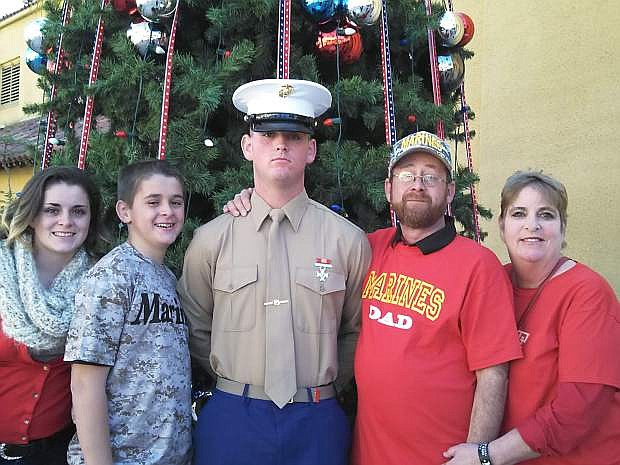 Marine Corps graduate Kyle Bell is pictured with his sister Kierra, brother Connor, and parents Mike and Lisa.