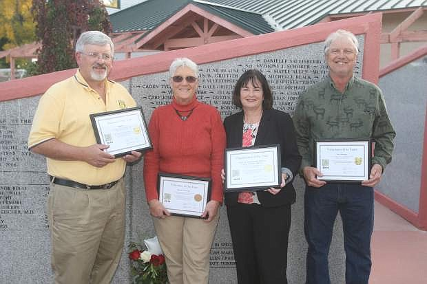 The Foundation for the Betterment of Carson City Parks and Recreation recognized, from left, Steve Reynolds of Sign Pro for Business of the Year, Donna Inversin, Volunteer of the Year, Lori Bagwell representing Carson City Redevelopment Authority Citizen Committee for Organization of the Year and Rex Jennings for Volunteer of the Years at Mills Park on Tuesday.
