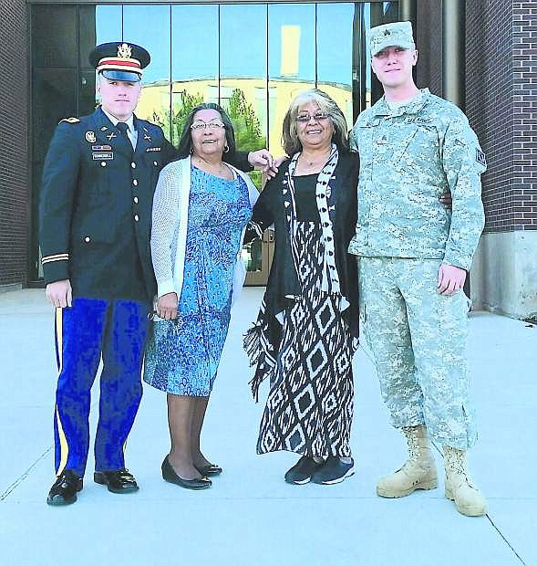 Thomas Edward Summerbell II  graduated from the University of Wyoming a Bachelor of Arts degree in Kinesiology and commissioned an officer in the Army National Guard as a second lieutenant.. From left are  SummerbelI,  grandmother Linda E. Oxborrow, aunt Jenivive A. Lucero and Sgt. Justin Berg.