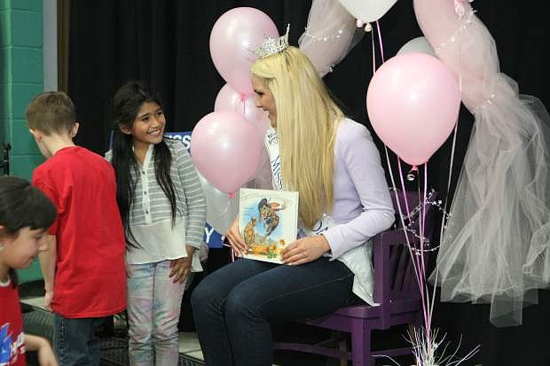 Miss Nevada Diana Sweeney talks with Mark Twain Elementary School students on Friday after reading 'The Tortoise and the Jackrabbit' by Susan Lowell.