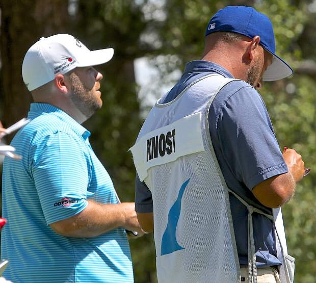 Colt Knost gets some advice from his caddy prior to teeing off on the 3rd hole at Montreux Saturday.