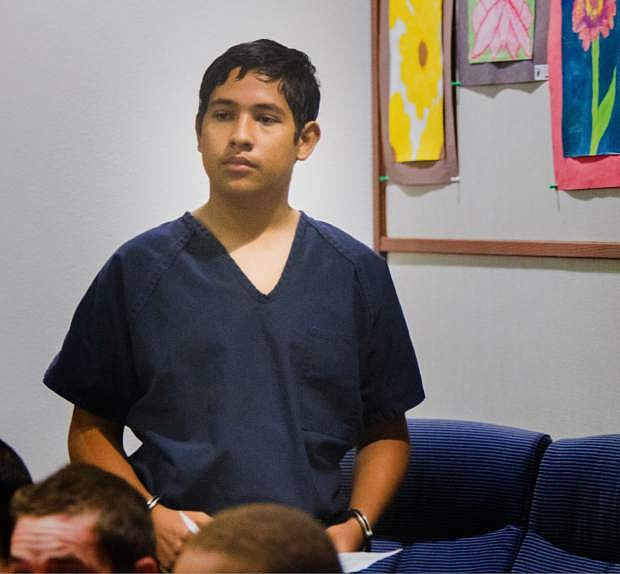 Adrian Navarro-Canales, 16, appears in Henderson Justice Court, in Henderson, Nev. Monday, Sept. 30, 2013,  on charges that he killed his mother and younger brother a day after celebrating his 16th birthday. Navarro-Canales is being prosecuted as an adult in the case.  (AP Photo/Las Vegas Review-Journal, Jeff Scheid)