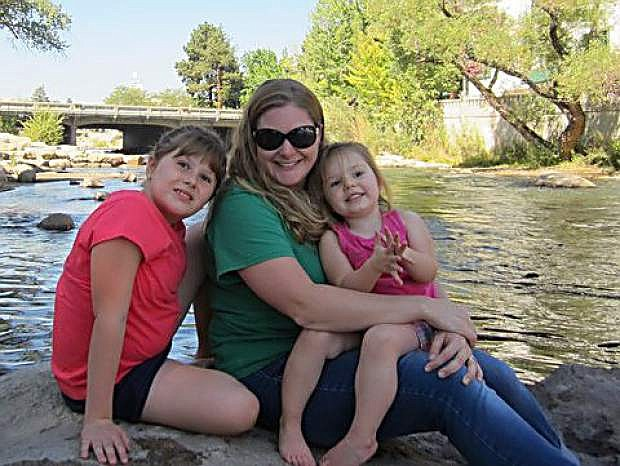 Megan Smith poses with daughters Becca, left, and Lauryn, right, at the Riverwalk in Reno.