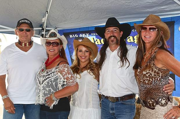Dennis Ambriz, Violetta Anna Licari, Alana Phillips, Jack Waggon and Stacy Irick, cast and crew of the Big Sky television show, pose for a photo at the Brews, Bikes and Bubbly festival Friday evening. For more information about the show visit bigskytvshow.com.