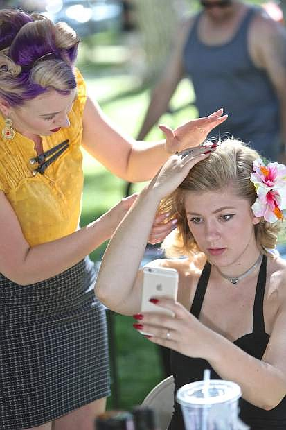 Briana Fahrbarger of Carson City has her hair done by Shelby Hedman Saturday.