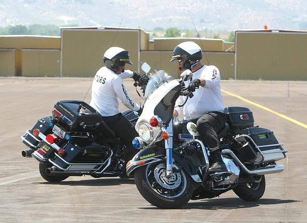 Carson City Sheriff Deputies Gary Denham and Thomas Miller train for the 12th annual Extreme Motor Officer Challenge this weekend.