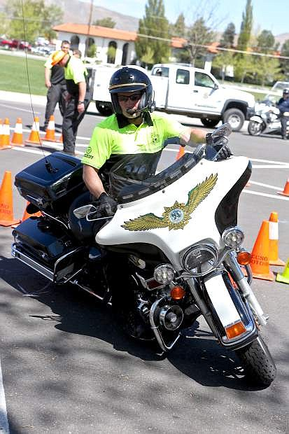 Deputy Matt Smith puts his Harley through its paces earlier this year at Mills Park.The Extreme Motor Officer Training Challenge returns this weekend.