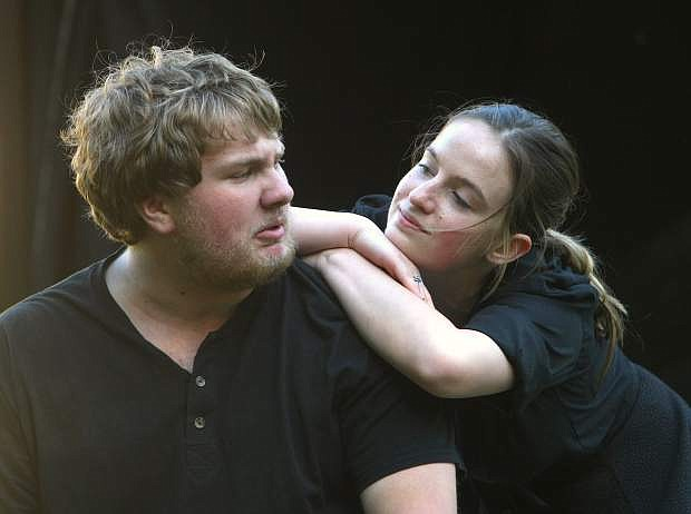 """Carson High School theater members Logan Osborne and Courtney Baxter perform a scene from William Shakespeare's """"Much Ado About Nothing"""" at the ampitheater on the Capitol grounds Tuesday night."""