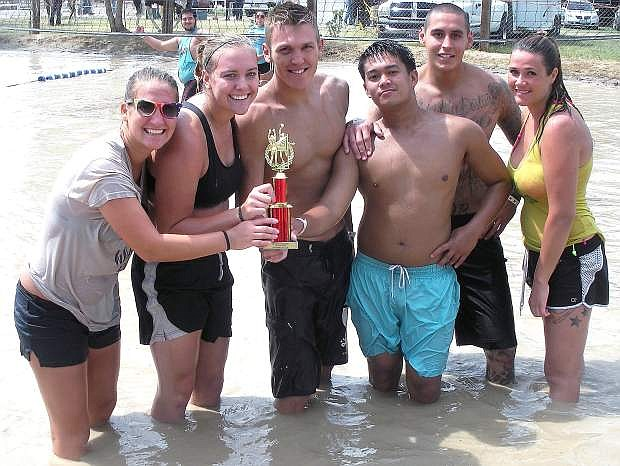 Chicken Lips captured the Cantaloupe crown as winners of the consolation bracket of the mud volleyball tournament.