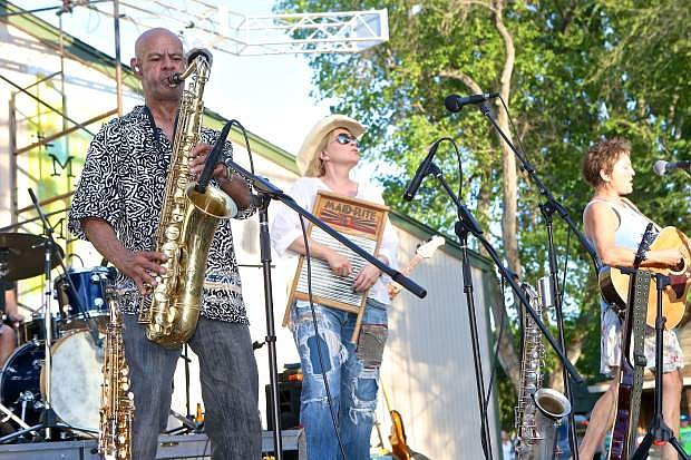 Reggy Marks, Chris Webster and Tracy Walton are the front three for the band Mumbo Gumbo who played on the opening night of the Levitt Amp Concert Series at the Brewery Arts Center/ Minnesota Street stage Saturday evening.