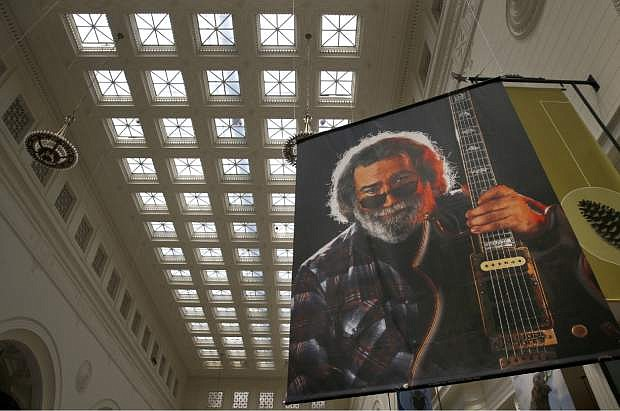 In this Tuesday, June 30, 2015, photo, a Herb Greene portrait of Jerry Garcia hangs as part of a Grateful Dead exhibit at the Field Museum in Chicago. The Dead are scheduled to perform multiple shows over the July 4th weekend at Soldier Field. (AP Photo/Charles Rex Arbogast)