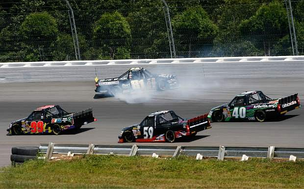 Ricky Ehrgott (81) spins out during the NASCAR Camping World Truck Series auto race Saturday Aug. 3, 2013, in Long Pond, Pa. Ryan Blaney won the race.  (AP Photo/Russ Hamilton Jr.)