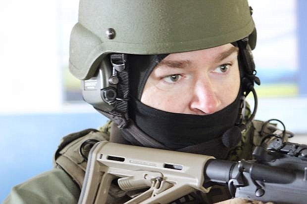 The eyes of a SWAT member keep vigil during a hostage crisis.