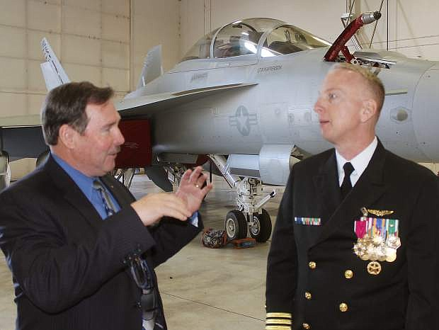 Capt. Leif Steinbaugh, who jsut completed his change of command ceremony, speaks with Steve Endacott.