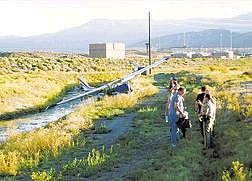 photo by Karl HoreisPilot Alfred Speckman, in gray shirt with brief case, talks with officers after he crash landed an early 1970's model 172 Cessna near the Waste Water Treatment Plant on North Edmonds Drive and East Fifth Street. Speckman and his two passengers were transported to Reno for treatment by a private party. No one was seriously hurt in the crash. The plane lost power near the airport and clipped a power line which started a small brush fire, which was extinguished.