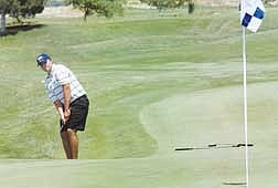 Photo by Rick GunnDaniel Timmons of Carson City hits a shot onto the 16th green during the Nevada State Amateur Tournament Tuesday morning.