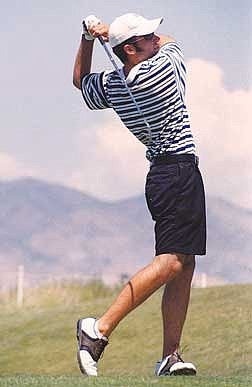 Photo by Brian CorleyBilly Harvey watches his ball of the 15th tee at Dayton Valley Country Club on Thursday.