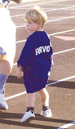 Brian Corley photo.Christopher Lawrence, 3, walks around the Carson High School track Friday evening during the Relay for Life. The little Carson City boy was diagnosed with leukemia when he was 1, but has been in remission for two years.