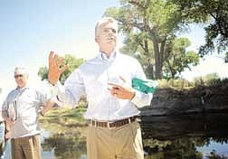 Brian Corley photo.Senator John Ensign talks about conservation along the Carson River during his tour of rural Nevada as Bob Milz looks on. About 75 showed up to voice their concerns and hear Ensign.