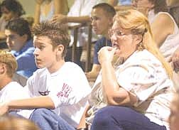 Brian Corley photoJohn Rowton, 15, and his mother, Judy Rowton, take in information Friday at Carson High School freshman orientation. Classes begin next week for Carson City students.