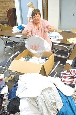 MaryEllen Radtke sorts underwear from one of nearly 50 boxes which were purchased wholesale from Kmart. Radtke, a Nevada Bell Pioneer, and is helping the school district's Children in Transition program, which provides clothing to disadvantaged students. Photo by Brian Corley