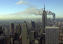 AP/Patrick SisonPlumes of smoke pour from the World Trade Center.